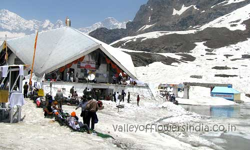Hemkund Sahib in June first week, the lake is semi frozen and Sikh Pilgrims take a dip in to it.